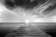 Old bridge and the sea. Black and white picture of old bridge to the sea Royalty Free Stock Photo