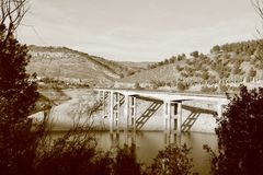 Old bridge in the south of Spain. Found a bridge while driving between a big mountain and a lake stock photography