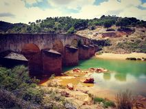 Old bridge in Spain. Andalusien old copper river stock image