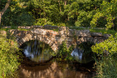 Old bridge. An old stone bridge by a stream Royalty Free Stock Images