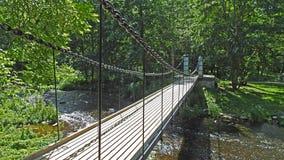 Old bridge throw river. Old bridge throw small river in Estonia Royalty Free Stock Photography