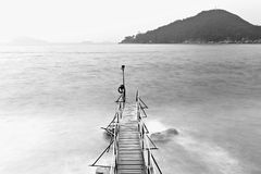 Old bridge to the sea in black and white Royalty Free Stock Photography