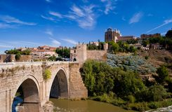 Old bridge to Toledo. An old bridge crossing over water to Toledo, Spain Royalty Free Stock Images