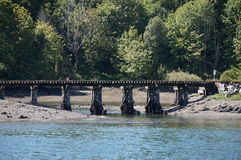 Old bridge. An old train trestle that crosses the Puget sound Stock Images