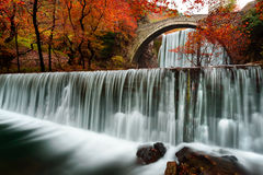 Old Bridge in Trikala Greece. With a double waterfall Royalty Free Stock Photography