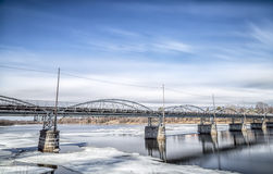 Old Bridge in Umeå, Sweden. With ice in the river and clouds in the sky Stock Image