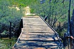 Old Bridge. Unused bridge at river crossing. Old memories of forgotten days long since passed Stock Photos