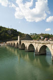 Old bridge in Visegrad town on Drina river - Bosnia and Herzegovina. Landscape photo stock image
