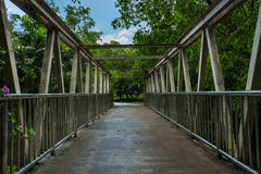 Old bridge walkway in the park. In the garden Stock Images