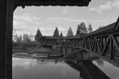 Old bridge in white and black. Wooden bridge over Loisach in Wolfratshausen Stock Photography