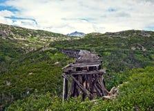 Old bridge on White Pass and Yukon Route Railway train ride Royalty Free Stock Photo