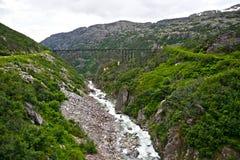 Old bridge on White Pass and Yukon Route Railway train ride Stock Images