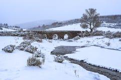 Old bridge in winter, Cantalojas Spain stock images