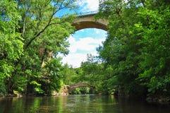Old bridges over the river La Cure Stock Images