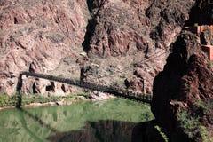 Old Bright Angel bridge over Colorado river Stock Photos