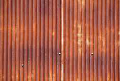 Old bright rust corroded metal goffered surface. Old vintage bright rusty stained corroded metal goffered surface Royalty Free Stock Photography