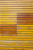 Old bright yellow wooden plank wall background Stock Image