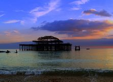 Old Brighton Pier sunset, England landscape Stock Photos