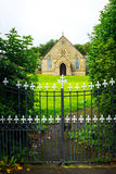 Old British church with metal gate Stock Photos