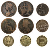 Old British Coins. Old English bronze and brass coins isolated on a white background royalty free stock images
