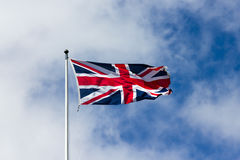 The Old British flag waving in the wind Stock Photo