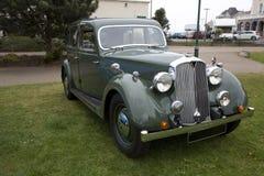 Old British green vintage saloon car Stock Image