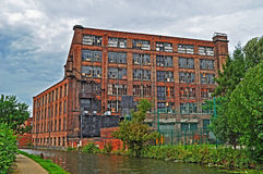 Old British mill on the canalside Royalty Free Stock Images
