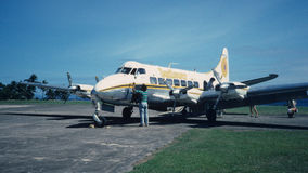 Old British Passenger landed Plane in Taveuni fiji. Old British Passenger Plane in Fiji, jungle airport.  The remote islands often have dirt or grass runways Royalty Free Stock Image