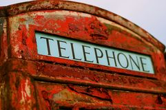Old British telephone box with peeling paint Royalty Free Stock Photography
