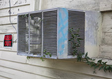 Old broken air conditioner in a window Royalty Free Stock Images