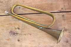 Old broken army trumpet Stock Images