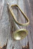 Old broken army trumpet Stock Photography