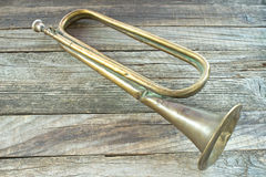 Old broken army trumpet Stock Image