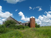 An old broken barn. A sunny summer day over an old barn Royalty Free Stock Photography