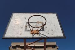 Old broken basketball hoop against the sky Stock Photos