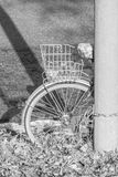 Old and broken bicycle chained at a street lamp Stock Image