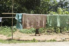 Old and broken blankets drying in a shack in northern Laos stock photos