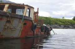 Old broken boat. A photo of an old fishing boat stock photo