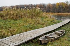 Old broken boat at the wooden floor royalty free stock image