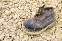 Old broken boot abandoned in the countryside.  stock image