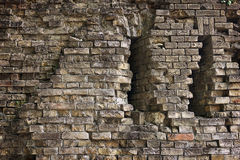 Old broken brick wall. Background old broken brick wall with loopholes closeup Stock Photography