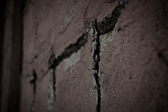 Old, broken brick wall in close-up. Background, wallpaper, pattern stock photography