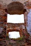 An old broken brick wall in an old castle. broken vaults. The old ruins of the collapsed walls with gates and windows Staroselskiy castle royalty free stock photos