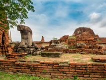 Old broken bricks and Buddha statue in Ayutthaya Historical Park. Of Thailand Stock Images