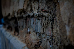 Old, broken bricks in the wall. In close-up. Background, wallpaper, pattern stock image