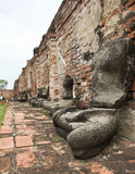 Old broken  buddha statue  sit set at Ayutthaya Royalty Free Stock Image