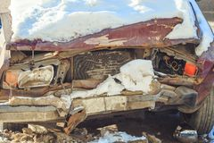 Old broken car in the snow. Old broken car after an accident in the snow royalty free stock image