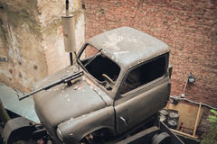 Old broken car with a machine gun. In one of the courtyards Lviv stock image