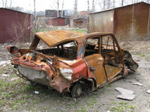 An old broken car. Rots in garages Royalty Free Stock Images