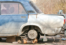 The old, broken car without wheels. Royalty Free Stock Photography